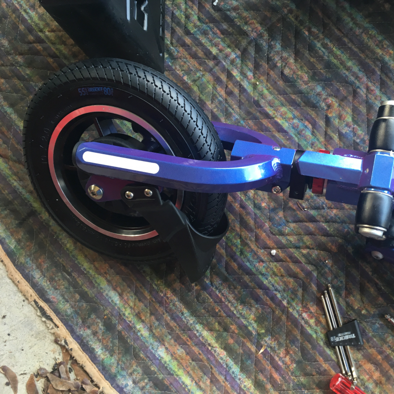 Closeup of front wheel and fork installed on Trikke T10 Roadster