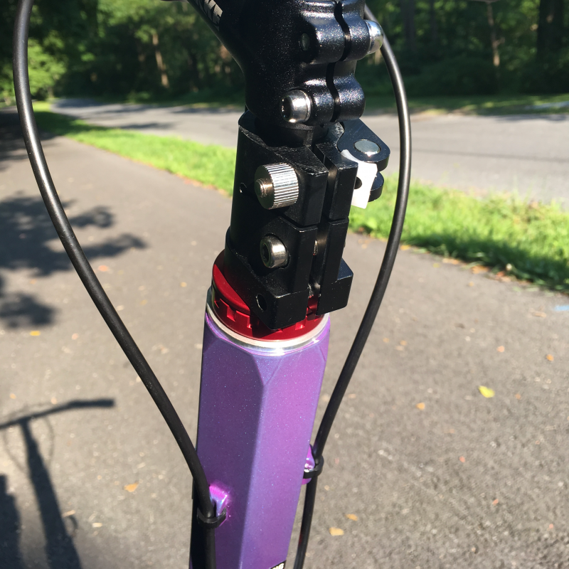 Closeup of the Trikke T10's headset and top of the main column